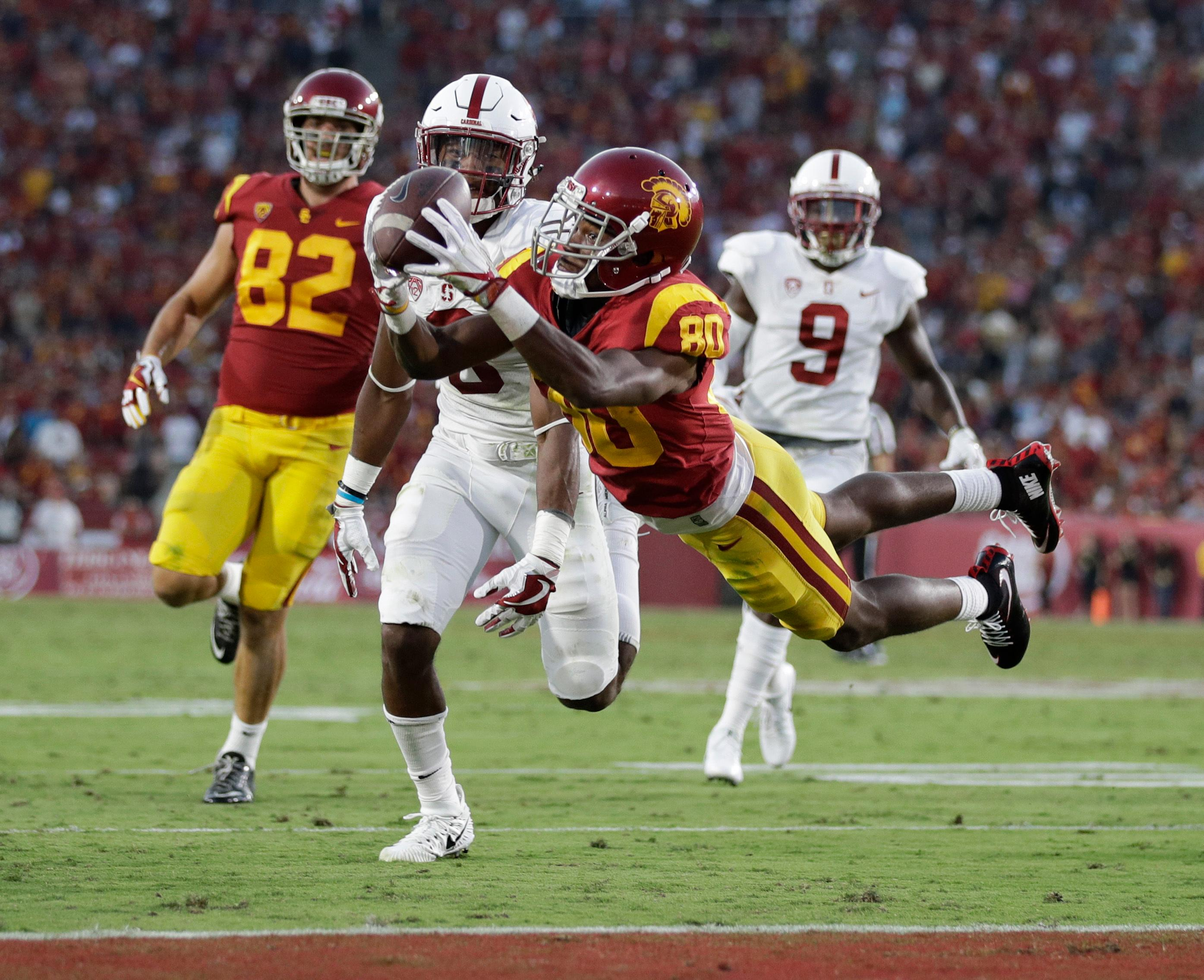 FILE - In this Sept. 9, 2017, file photo, Southern California's Deontay Burnett, center, catches a touchdown pass during the first half of an NCAA college football game against Stanford, in Los Angeles. Burnett was selected to the AP All-Conference Pac-12 team announced Thursday, Dec. 7, 2017. (AP Photo/Jae C. Hong, File)