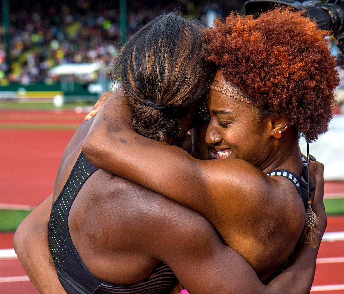 The podium of the 100 meter hurdles final embrace in a hug. Nike' Brianna Rollins won with a time of 12.34, Kristi Castlin finished second, and Nike's Nia Ali finished third. Photo by August Frank, Oregon News Lab