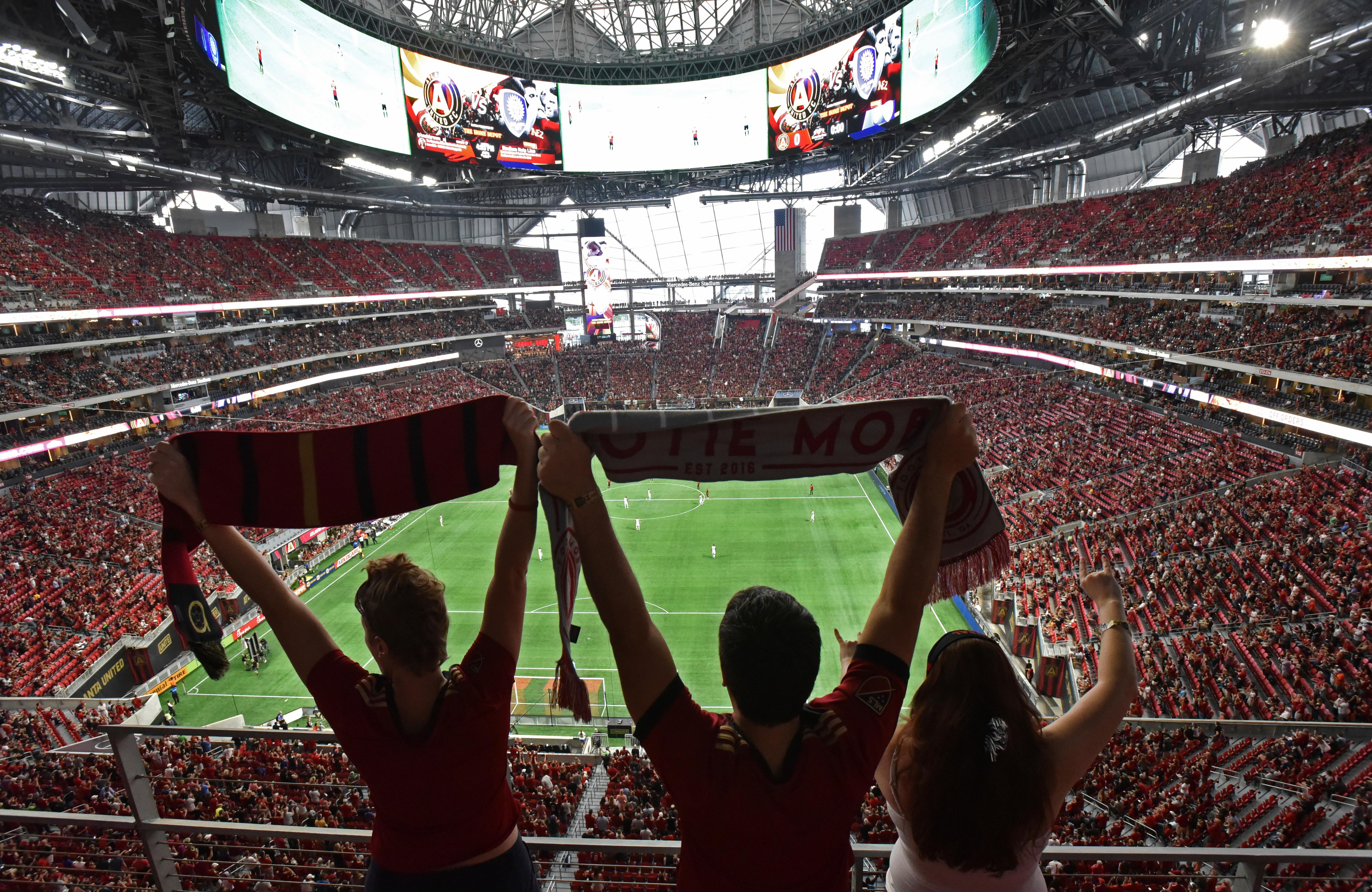 FILE - In this Sept. 16, 2017, file photo, Atlanta United fans cheer for their team before an MLS soccer match against the Orlando City in Atlanta. Welcome to Atlanta, soccer's newest hotbed, which amazingly enough has sprouted up in a city known for its fickle sports fans and plenty of heartbreak from its teams.  (Hyosub Shin/Atlanta Journal-Constitution via AP, File)