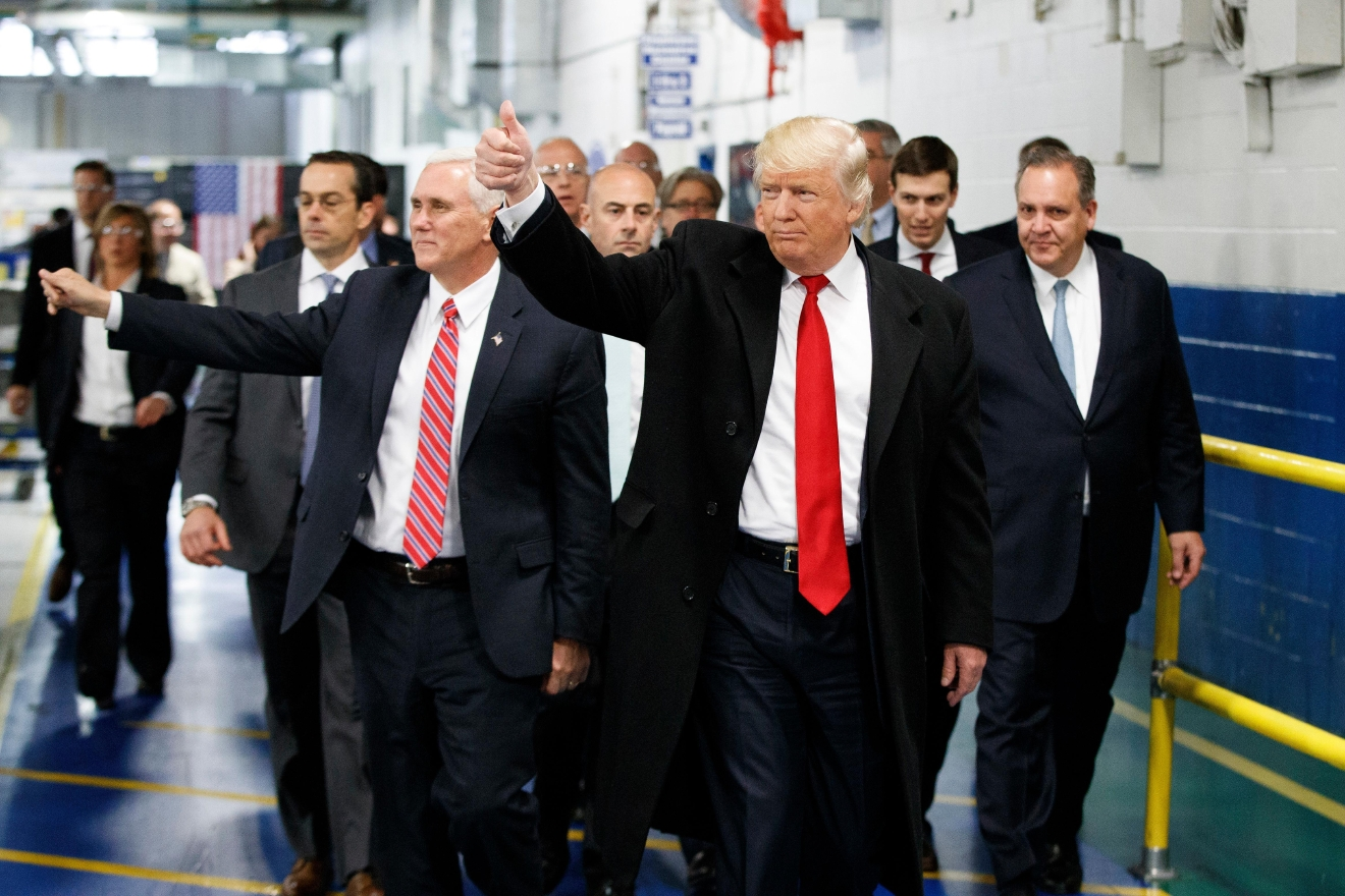 FILE - In this Dec. 1, 2016, file photo, President-elect Donald Trump and Vice President-elect Mike Pence wave as they visit to Carrier factory in Indianapolis, Ind. Donald Trump enters the White House on Jan. 20 just as he entered the race for president: defiant, unfiltered, unbound by tradition and utterly confident in his chosen course. In the 10 weeks since his surprise election as the nation's 45th president, Trump has violated decades of established diplomatic protocol, sent shockwaves through business boardrooms, tested long-standing ethics rules and continued his combative style of replying to any slight with a personal attack _ on Twitter and in person. (AP Photo/Evan Vucci, File)
