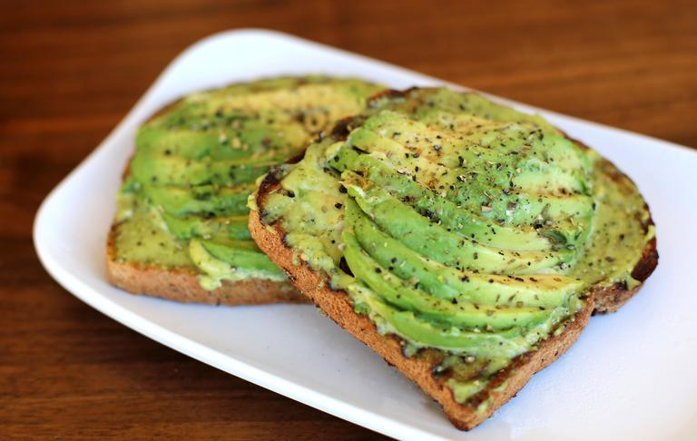 The avocado toast at{&amp;nbsp;}Fruitive gains a flavor boost from pesto mayo and herbs. (Photo courtesy of Fruitive)<p></p>