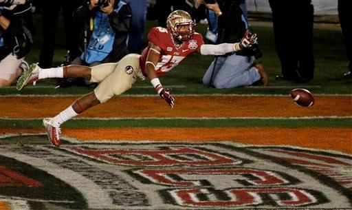 Florida State's Jalen Ramsey can't quite intercept a pass during the second half of the NCAA BCS National Championship college football game against Auburn Monday, Jan. 6, 2014, in Pasadena, Calif.