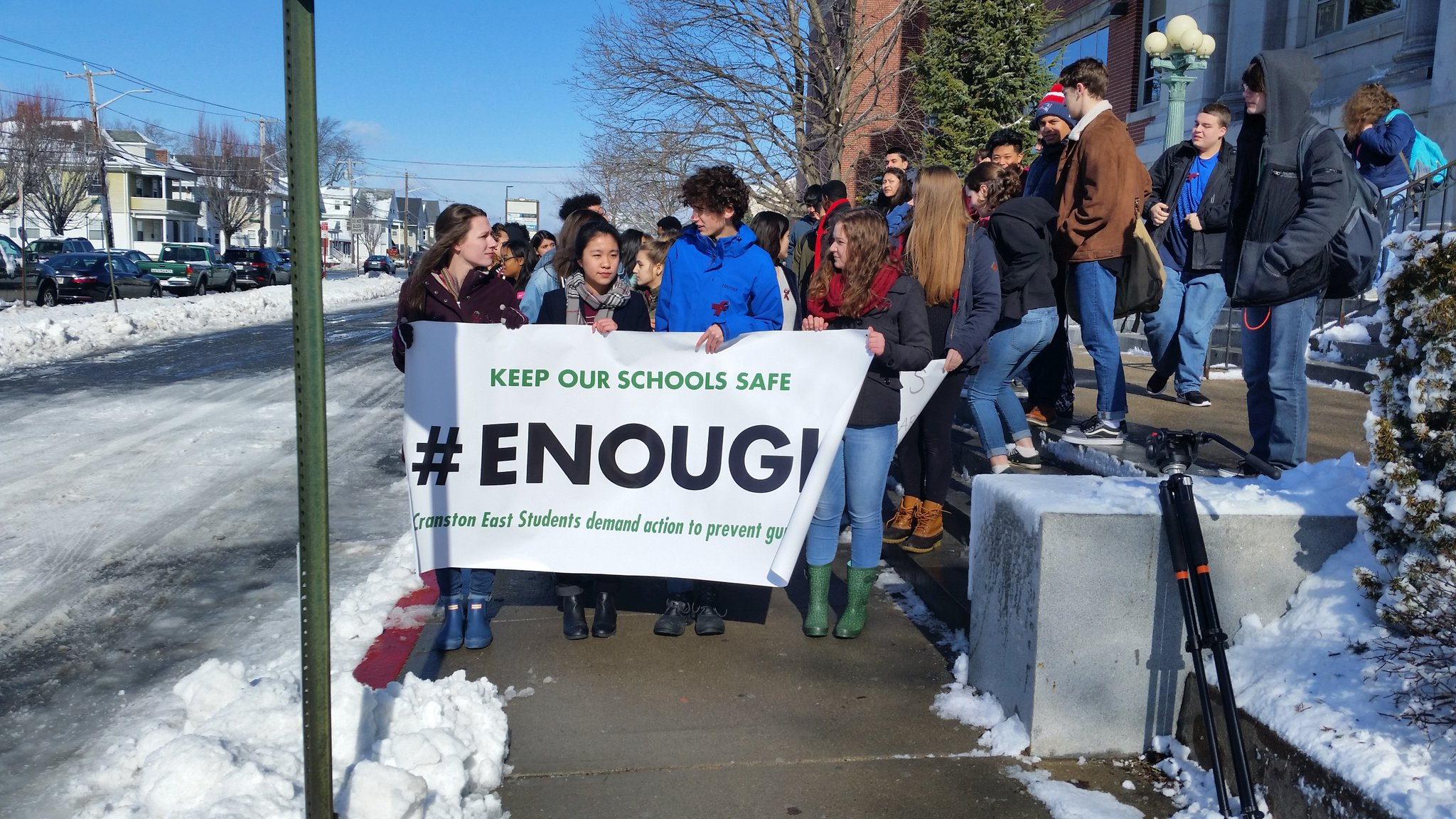 Students at Cranston High School East hold a banner demanding action to prevent gun violence during National School Walkout on Wednesday, March 14, 2018. (WJAR)