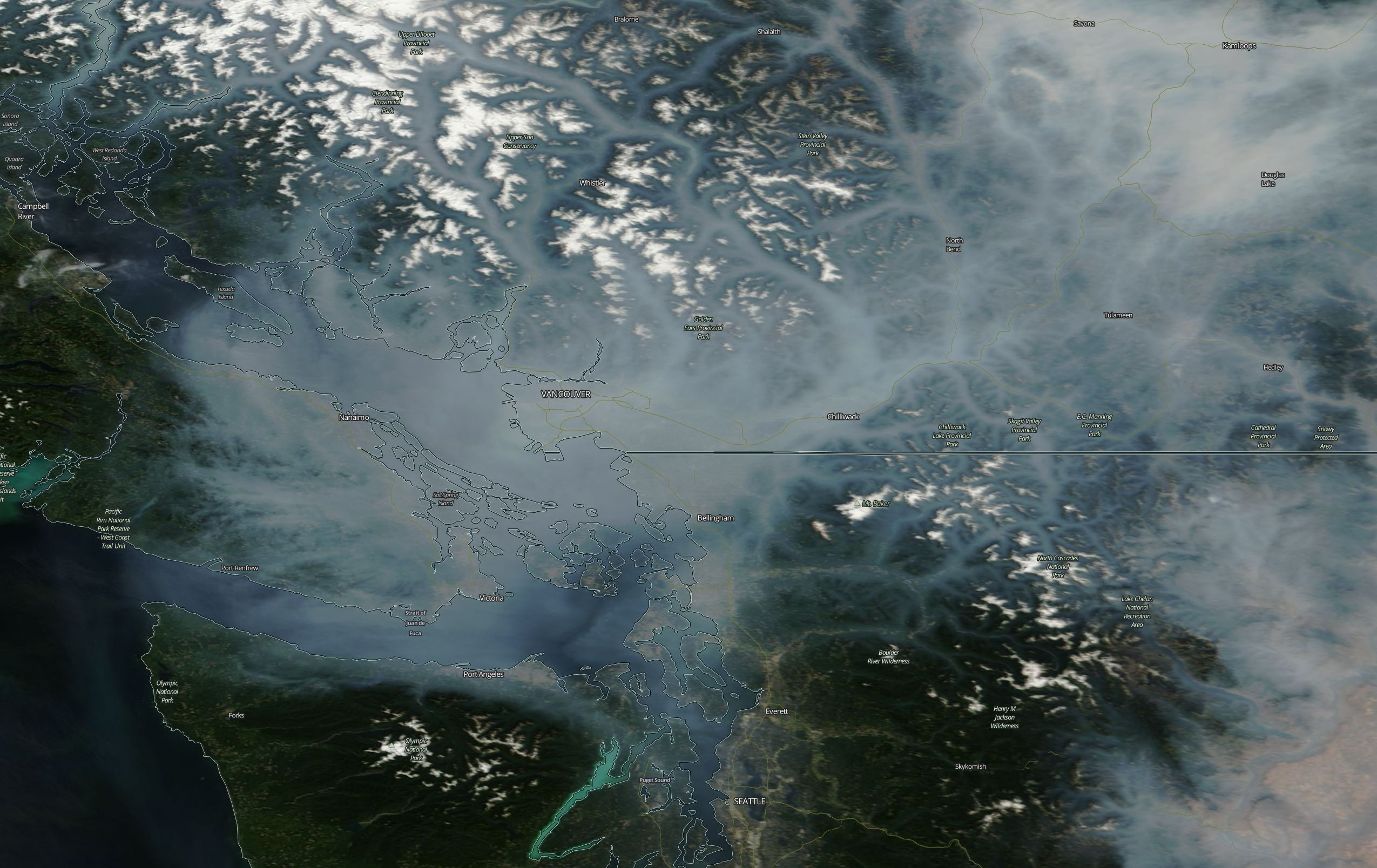 Photo from NASA MODIS satellite taken on Aug. 1, 2017 showing wildfire smoke spreading south into Western Washington (Photo: NASA/MODIS)