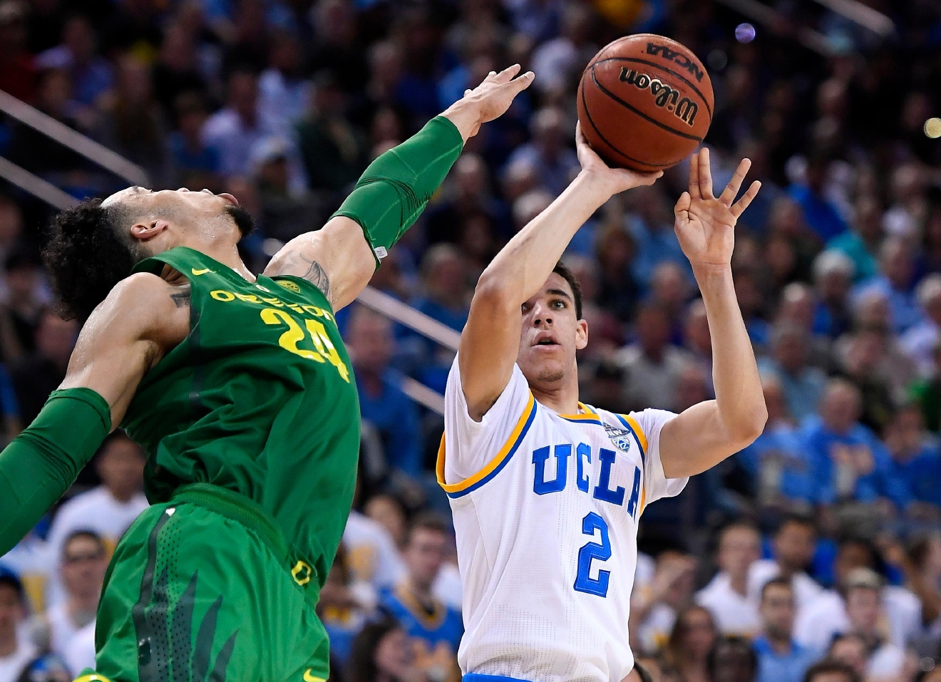 UCLA guard Lonzo Ball, right, shoots as Oregon forward Dillon Brooks defends during the second half of an NCAA college basketball game, Thursday, Feb. 9, 2017, in Los Angeles. UCLA won 82-79. (AP Photo/Mark J. Terrill)