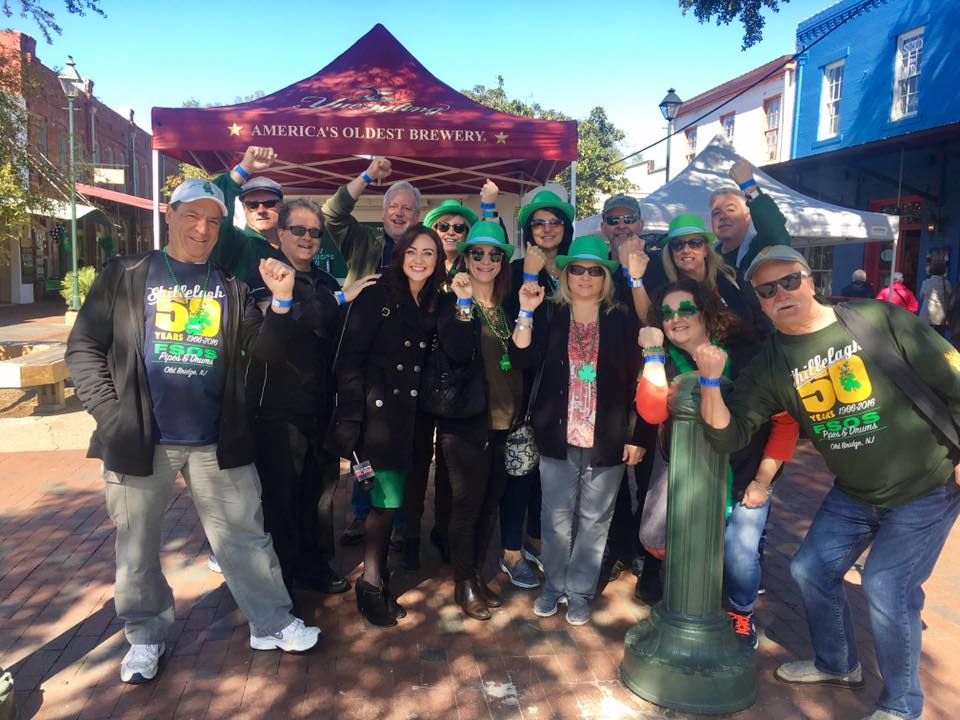 The Sons of the Shillelagh & their ladies right after they got their $10 to-go drinking wristbands on Thursday. (Josie Gregory/WTGS)