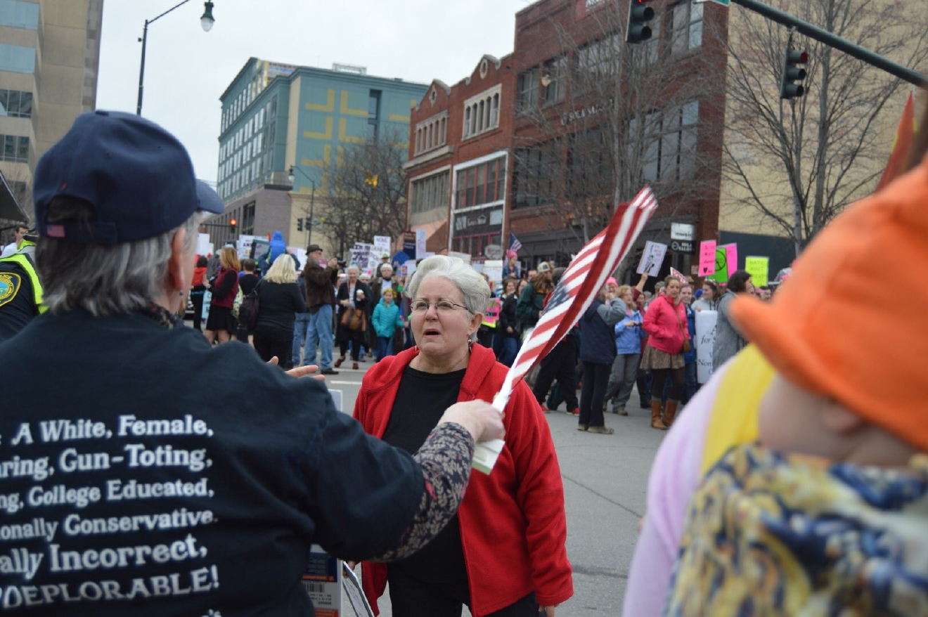 "Heated words from marcher to anti-abortion contingent. ""We're gonna keep our eye on (Trump)."" (Photo credit: WLOS staff)"