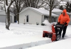 A person clears snow in Manitowoc March 13, 2017.