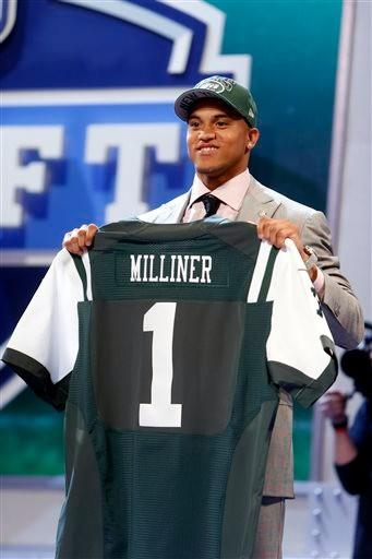 Dee Milliner, from Alabama, holds up a team jersey after being selected ninth overall by the New York Jets in the first round of the NFL football draft, Thursday night.