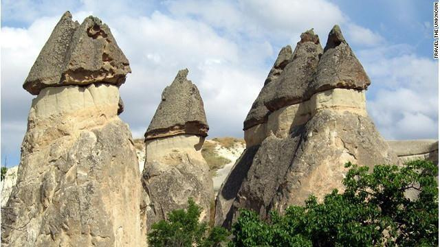 "This remote area of Central Turkey is covered in amazing ""fairy chimneys"" %u2014 volcanic peaks through which it's possible to trek, explore the caves of an underground city or survey from above in a hot air balloon or helicopter."