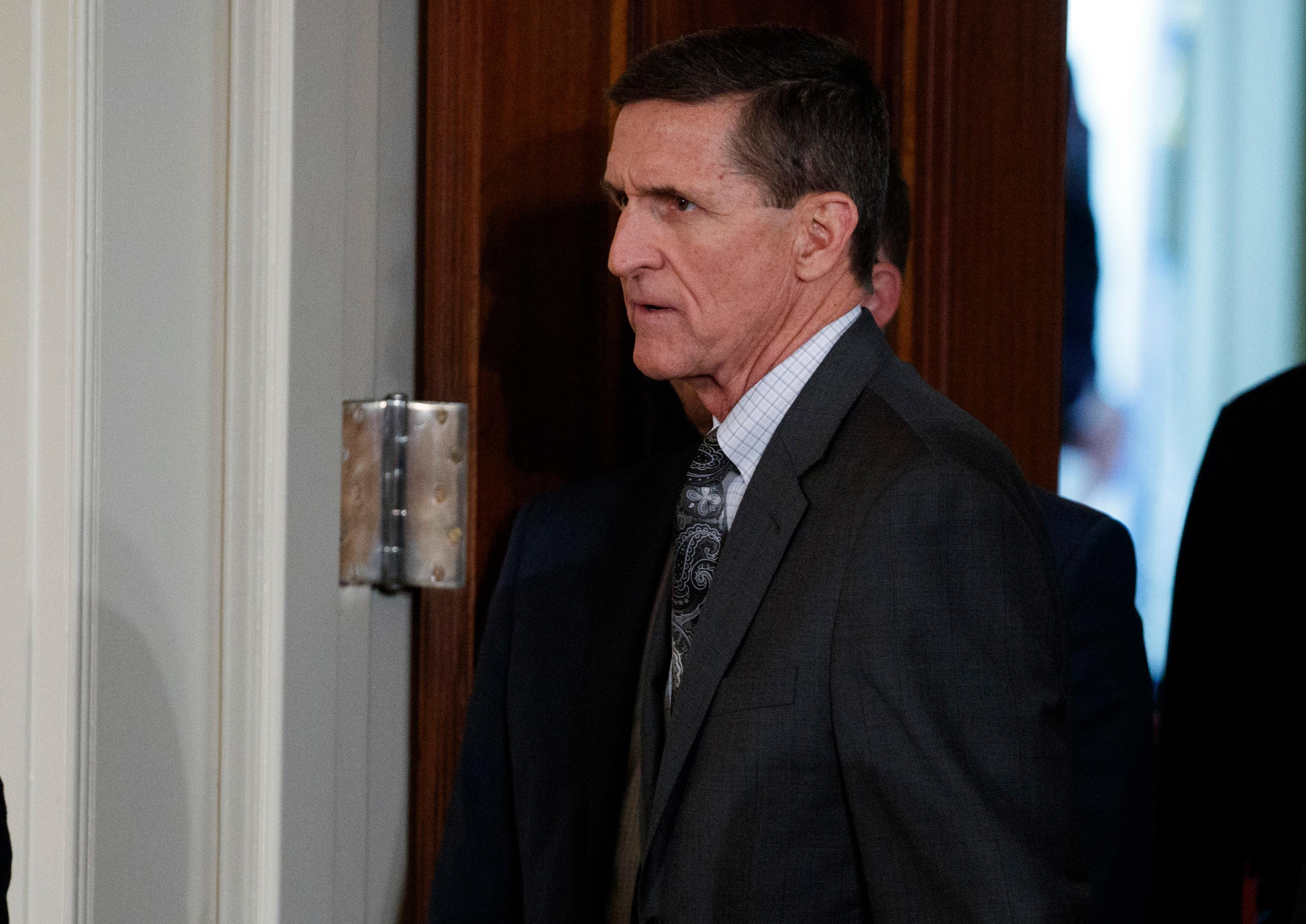 FILE - In this Feb. 13, 2017 file photo, Mike Flynn arrives for a news conference in the East Room of the White House in Washington. The former national security adviser will invoke his Fifth Amendment protection against self-incrimination on Monday, May 22, 2017, as he notifies the Senate Intelligence committee that he will not comply with a subpoena seeking documents. (AP Photo/Evan Vucci, File)