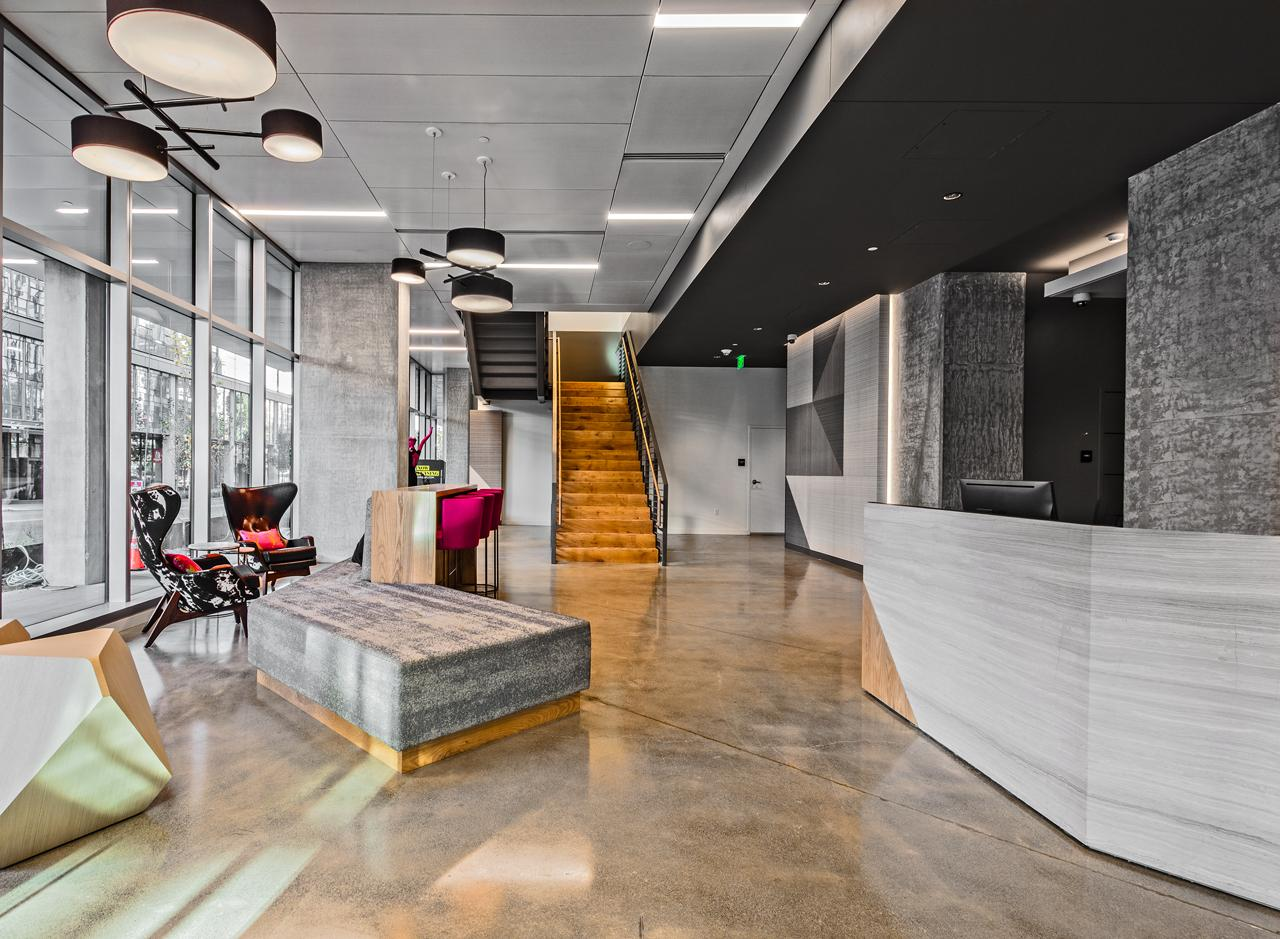 In the lobby, concrete and stone combine with wood and metal accents for industrial-chic perfection.<p></p>