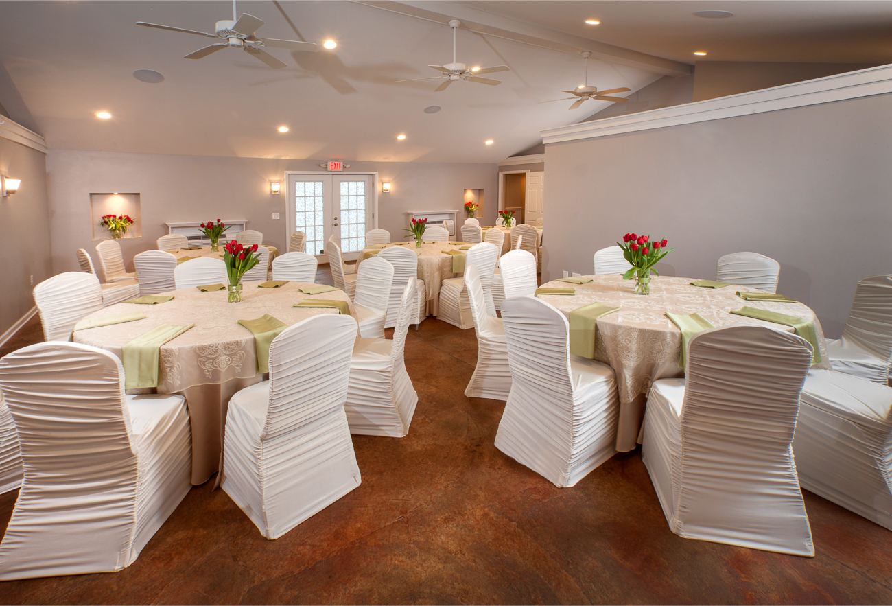 The event space has both a two-story indoor area as well as a beautiful outdoor courtyard. The 1,800-square-foot indoor area can seat 64 people. It has an attached kitchen, bathrooms, and an upstairs lounge area. The courtyard can seat an equal amount of people for weddings, rehearsal dinners, birthdays, and any other type of gathering. / Image: Wayne Litmer Photography // Published: 1.8.21