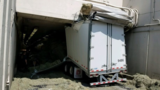18-wheeler carrying hay stuck in Bankhead Tunnel