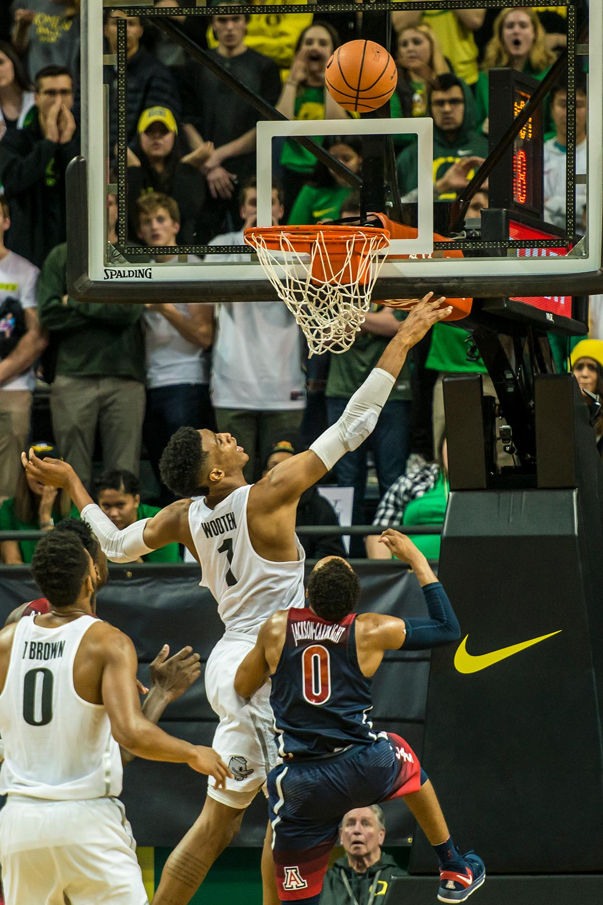 Oregon's Kenny Wooten (1) goes for a layup over Arizona's Jackson-Cartwright (0) in their matchup at Matthew Knight Arena Saturday. The Ducks upset the fourteenth ranked Wildcats 98-93 in a stunning overtime win in front of a packed house of over 12,000 fans for their final home game to improve to a 19-10 (9-7 PAC-12) record on the season. Oregon will finish out regular season play on the road in Washington next week against Washington State on Thursday, then Washington on the following Saturday. (Photo by Colin Houck)