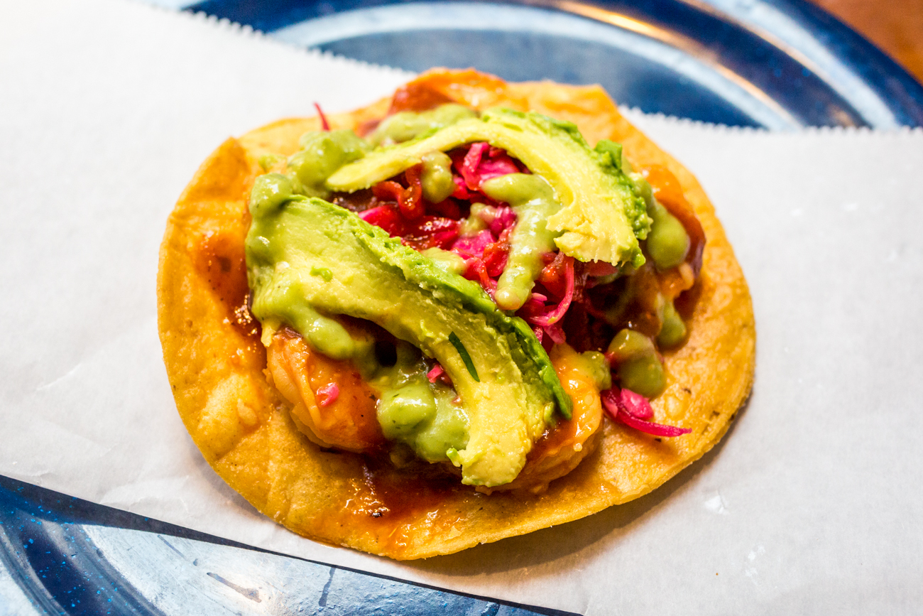 Camarones (Shrimp) Tostada: crispy corn tortilla topped with shrimp, avocado salsa, salsa de tamarindo, pickled red cabbage, and fresh avocado / Image: Catherine Viox{ }// Published: 8.31.19