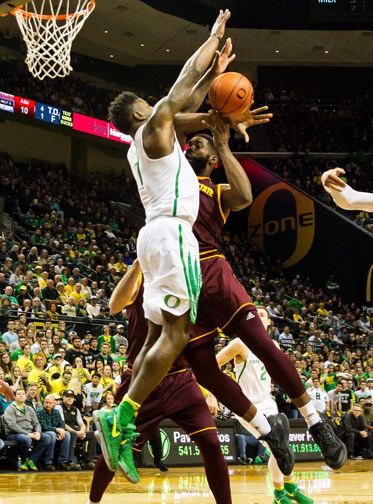 Oregon forward Jordan Bell (#1) blocks an attempted layup by Arizona State forward Obinna Oleka (#5). The Oregon Ducks defeated the Arizona State Sun Devils 71 to 70. Photo by Ben Lonergan, Oregon News Lab