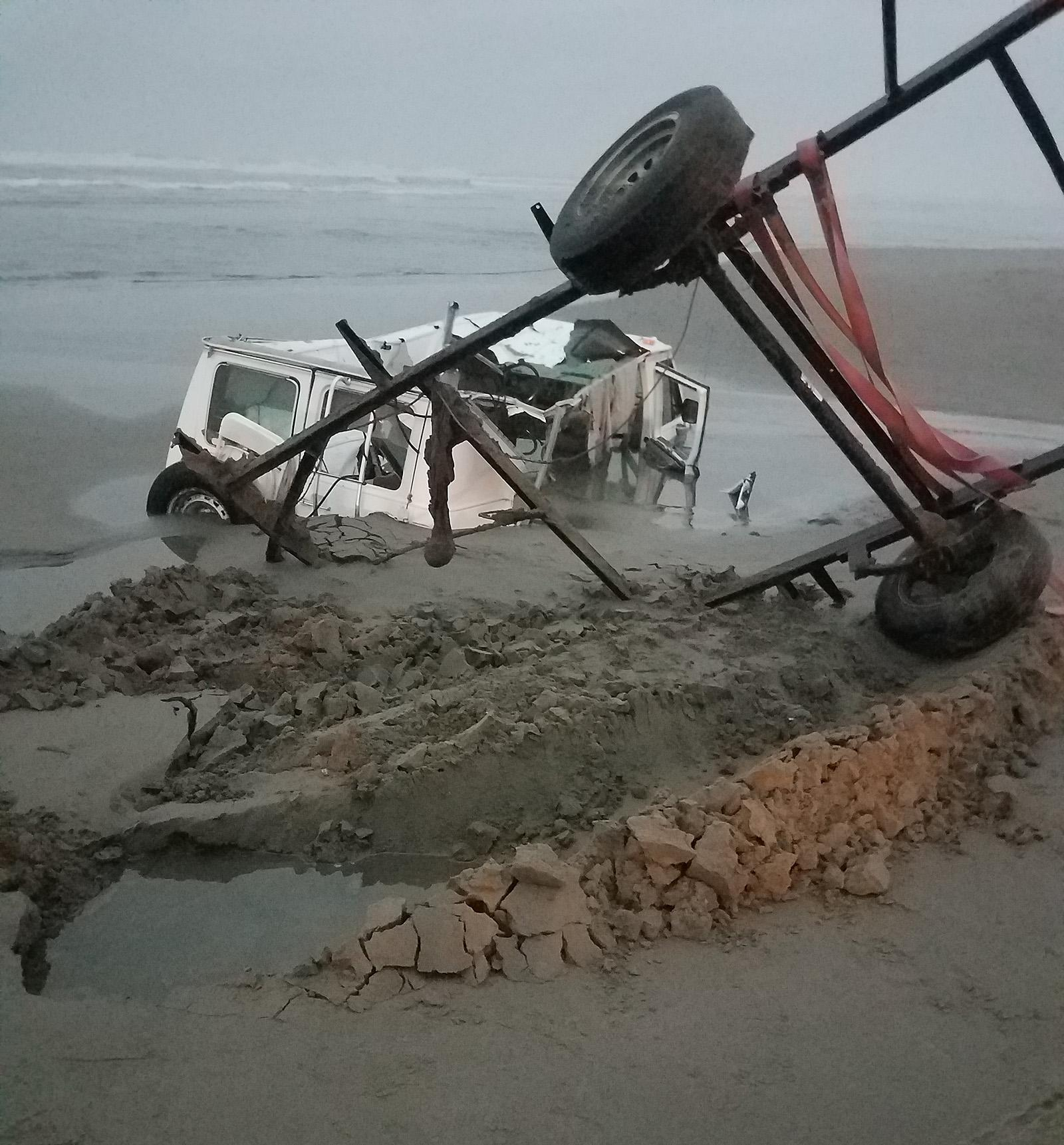 Van and trailer submerged on Oregon Coast - Photo courtesy the Clackamas County Sheriff's Office