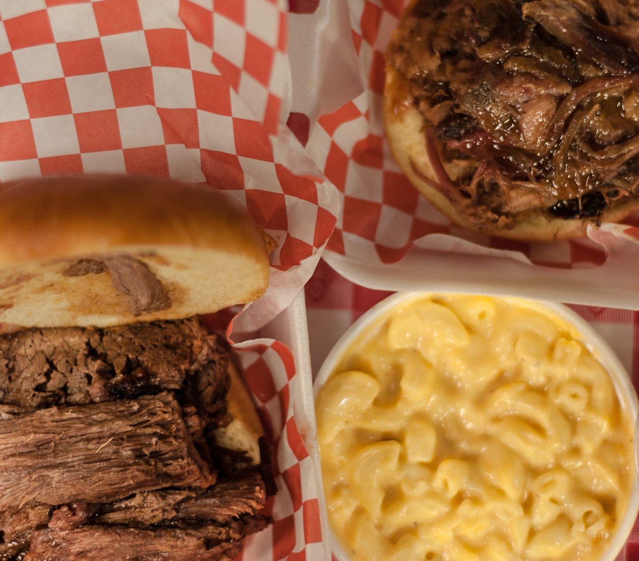 Full brisket sandwich, pulled pork sandwich, and mac & cheese{ }/ Image: Kellie Coleman // Published: 6.19.20