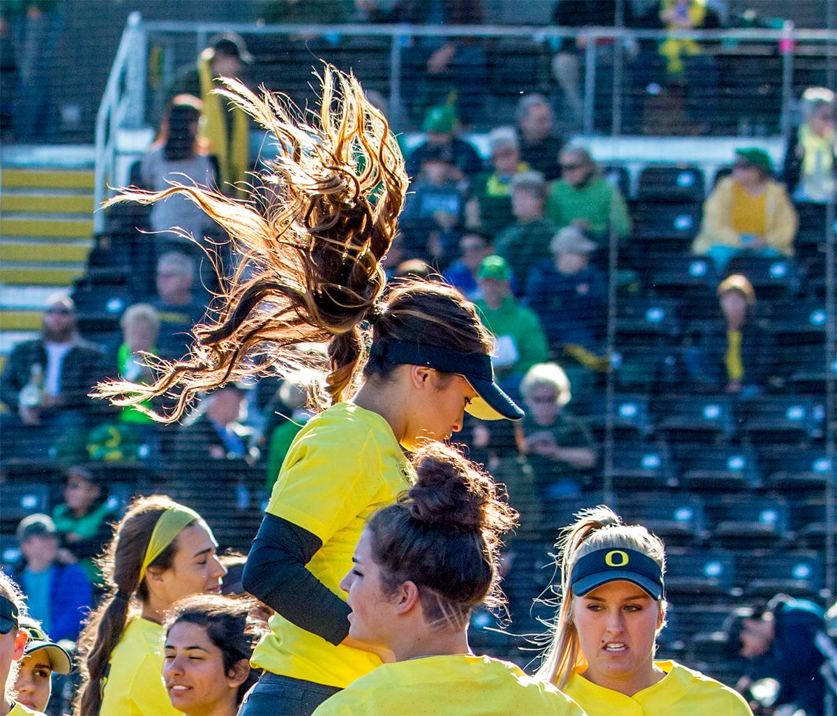 The Duck's Sammie Puentes (#5) jumps into the air as the team gets pumped up for the game. The Oregon Ducks defeated the Oregon State Beavers 8-0 in game one of the three-game Civil War series on Friday night at Jane Sanders Stadium. The game was 0-0 until Gwen Svekis (#21) hit a solo home run in the fourth inning. Mia Camuso hit a grand slam in the fifth inning, ending the game for the Ducks by mercy rule. With tonight's victory, the Ducks are 39-6 and 12-6 in Pac-12 play. Photo by August Frank, Oregon News Lab
