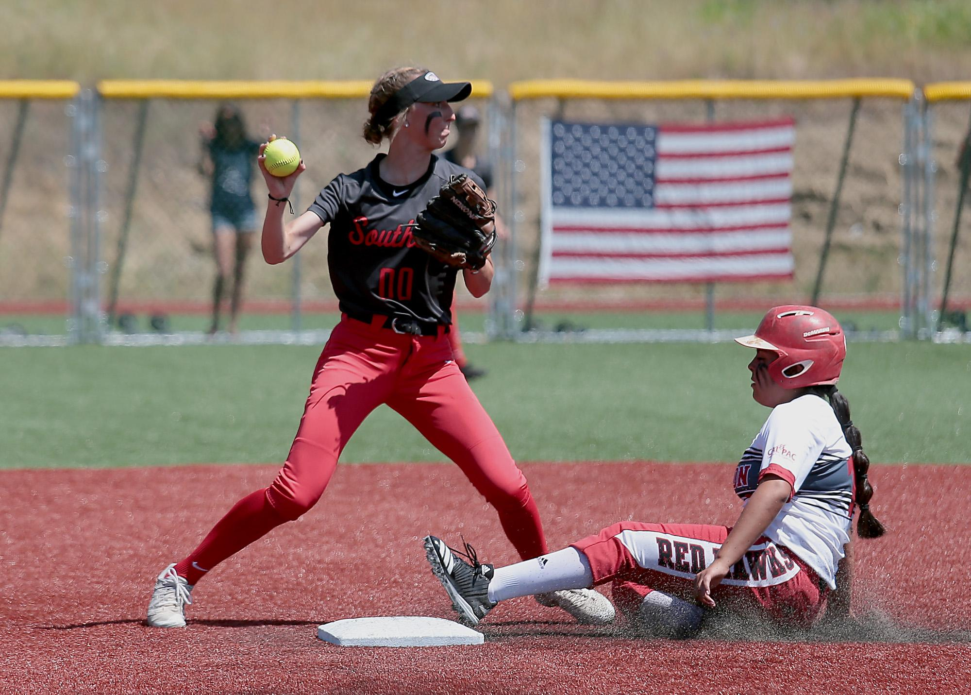 Southern Oregon University Infielder Hannah Shimek attempts to turn the double play over Simpson University baserunner Alexis Parras at US Cellular Fields on Monday.[PHOTO BY:  LARRY STAUTH JR]