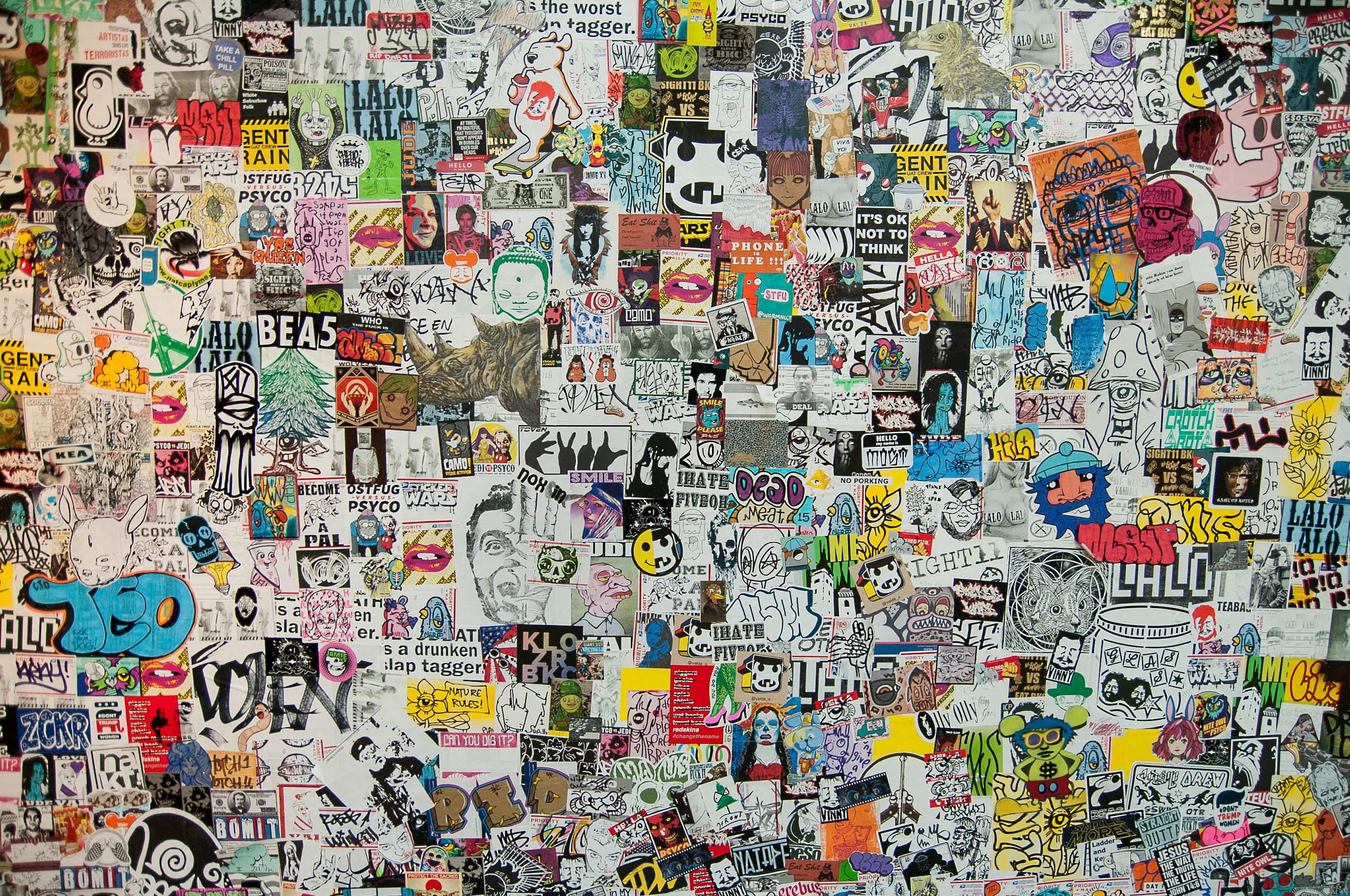 "In August 2013, he received permission to cover one 12.5-foot-by-20-foot wall in the gallery with approximately 10,000 stickers. The sticker bomb was part of a series of exhibitions in November 2013 known as ""Elements of Hip Hop,"" by Emma Fisher and Asad Walker.(Image: Nikkia Redd Photography)"