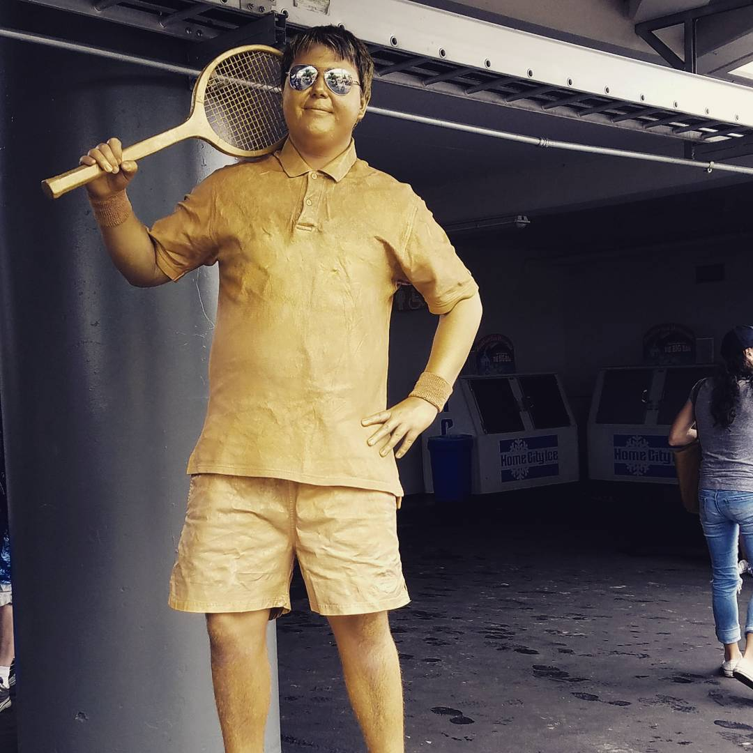 IMAGE: IG user @juggling_away / POST: Day 3 of living statue. Having a golden day. #cincinnaticircuscompany #atp #cincytennis #livingstatue""