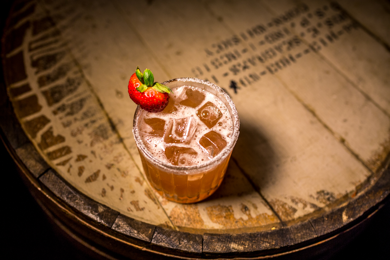 The 1841: Woodford Reserve Bourbon, Cointreau, strawberry simple syrup, apple cider, lemon juice, with a sugared rim, and garnished with a strawberry / Image: Catherine Viox{ }// Published: 7.30.19