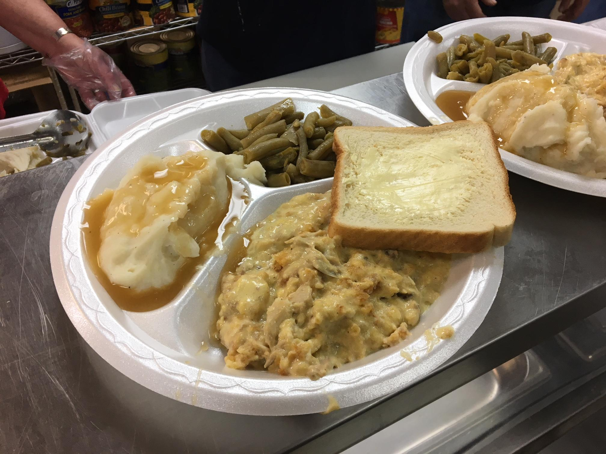 The monthly hot meal is paid for and cooked by the Happy Hour Life Point Group at the Church at Grace Point.{&amp;nbsp;}(Image: WTVC)<p></p>