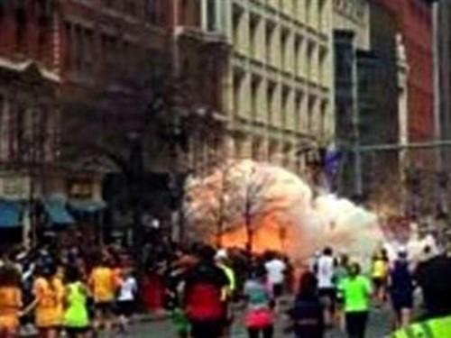 In this image from video provided by WBZ TV, spectators and runners run from what was described as twin explosions that shook the finish line of the Boston Marathon, Monday, April 15, 2013, in Boston.