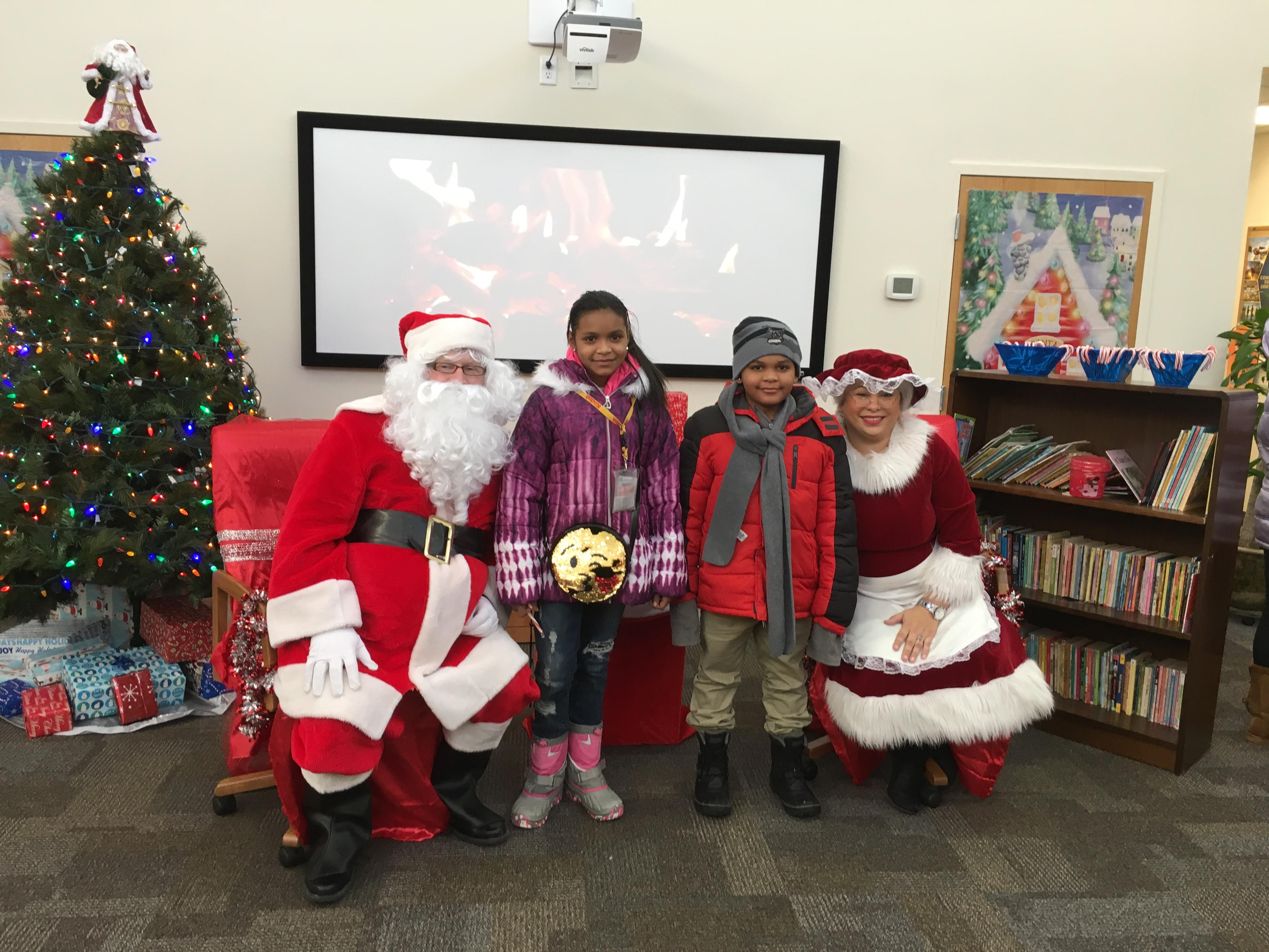 Local children receive holiday toys and gifts. (Photo: Rochester Housing Authority.)<p></p>