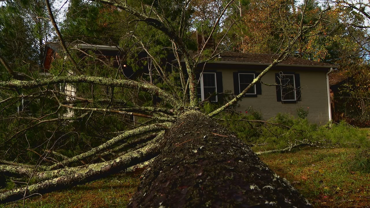 Crews in Hendersonville spent Thursday responding to calls, placing barricades and beginning clean-up efforts from Tropical Storm Zeta. (Photo credit: WLOS staff)