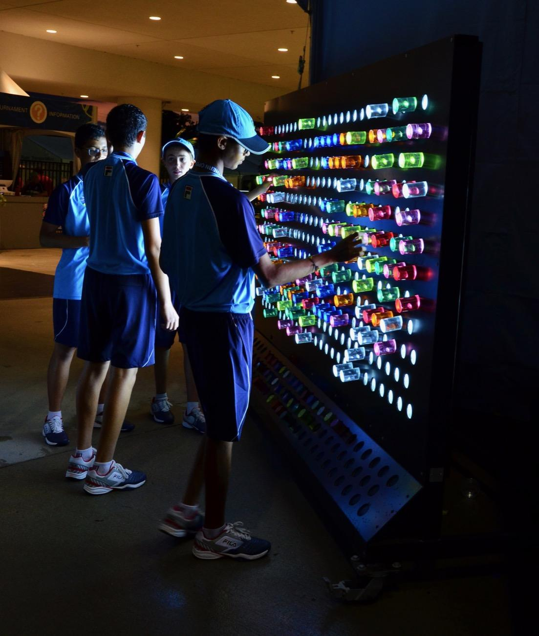 "Ball boys enjoying the BLINK ""Light Brite"" display during some down time between matches / Image: Leah Zipperstein // Published: 8.15.19"
