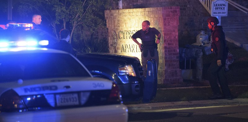 <p>New Orleans Police, State Police and ATF members respond to the shooting of an officer near the Cypress Parc Apartments in New Orleans, La. Friday, Oct. 13, 2017. (Matthew Hinton/The Advocate via AP)</p>
