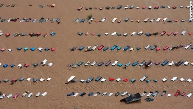 Parked vehicles sit partially submerged near Greeley, Colorado, on Saturday, September 14.