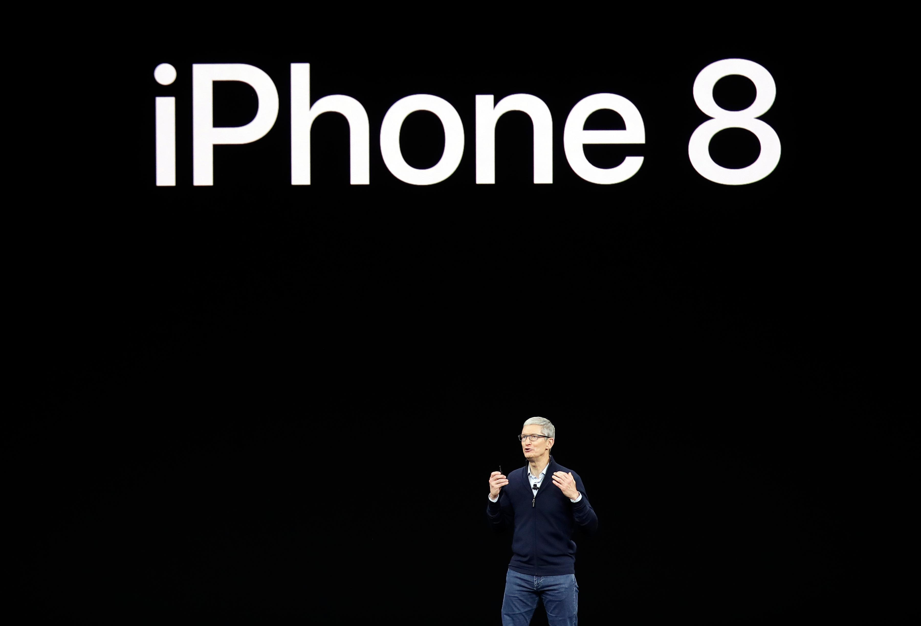 Apple CEO Tim Cook, discusses the new iPhone 8 at the Steve Jobs Theater on the new Apple campus on Tuesday, Sept. 12, 2017, in Cupertino, Calif. (AP Photo/Marcio Jose Sanchez)