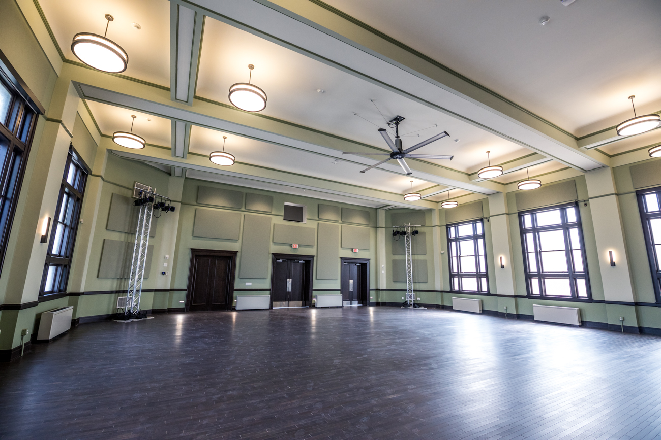 The Shawnee Ballroom features restored globe lighting and the original building's stage. The flooring is new engineered hardwood. / Image: Catherine Viox // Published: 10.30.20