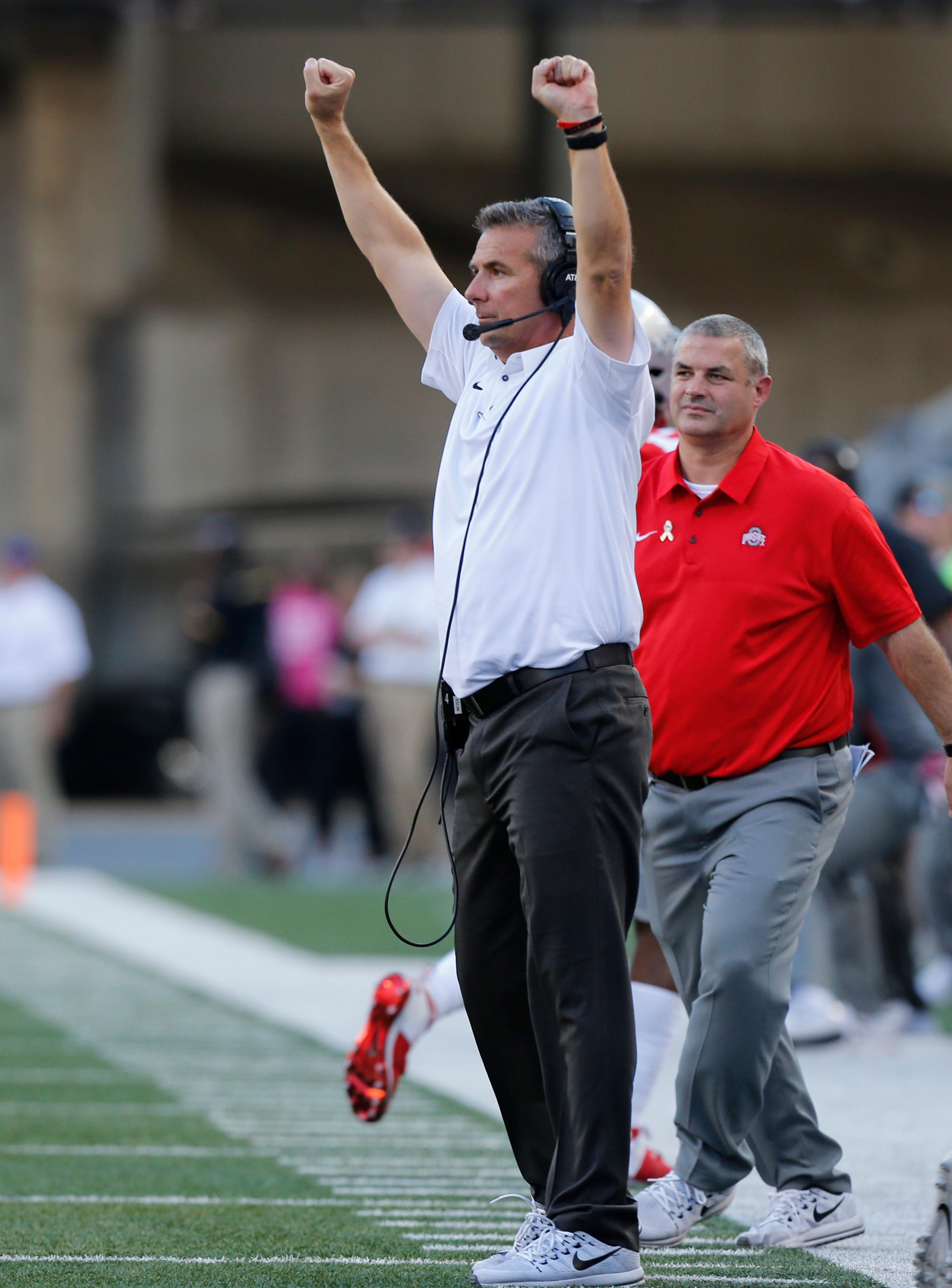 Ohio State head coach Urban Meyer celebrates a touchdown against Maryland during the first half of an NCAA college football game Saturday, Oct. 7, 2017, in Columbus, Ohio. (AP Photo/Jay LaPrete)