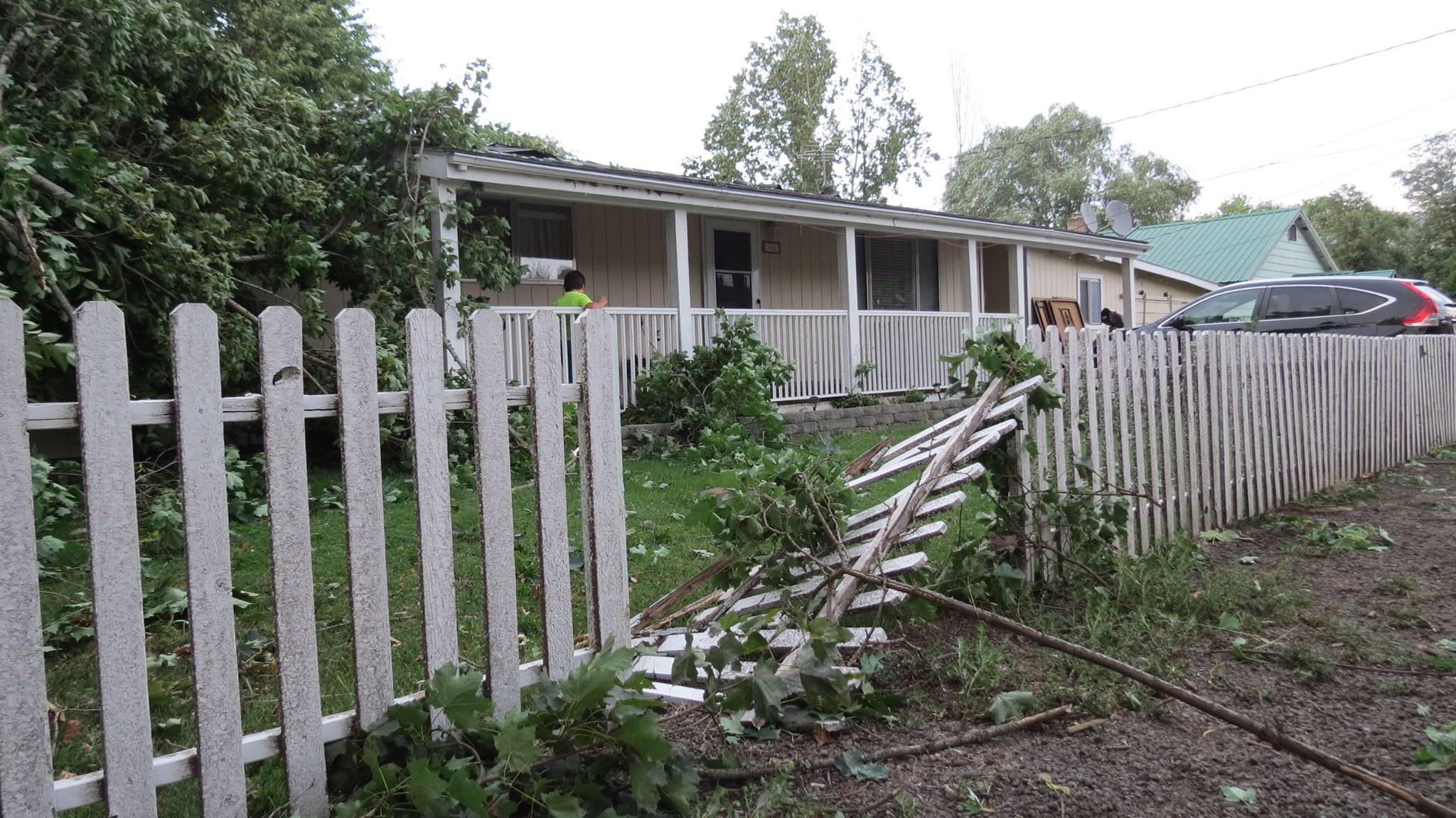 Kathy Zimmerman shows a damaged fence in Kamiah from Tuesday's storm.