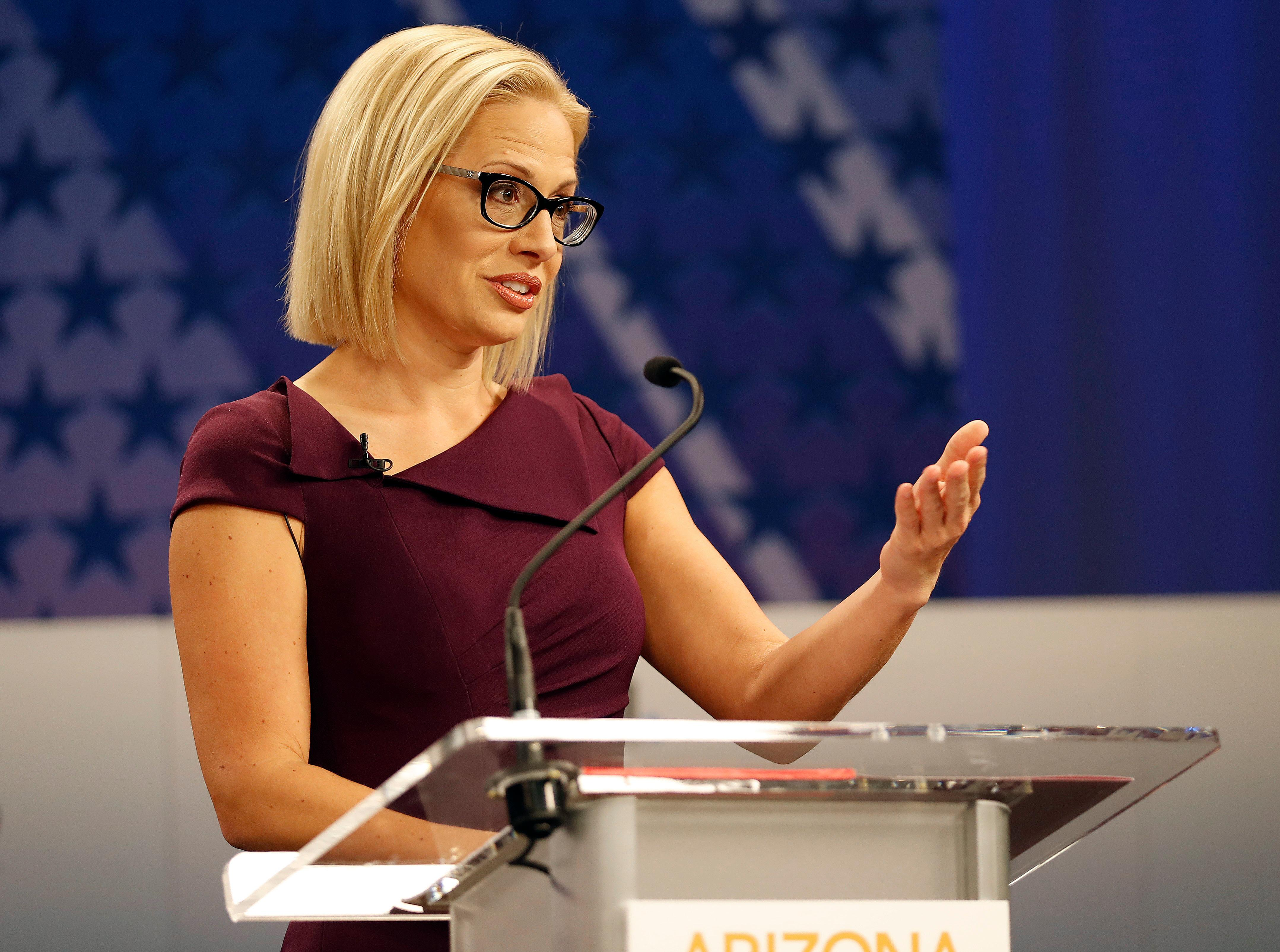 U.S. Rep. Kyrsten Sinema, D-Ariz., goes over the rules in a television studio prior to a televised debate with U.S. Rep. Martha McSally, R-Ariz., Monday, Oct. 15, 2018, in Phoenix. Both ladies are seeking to fill the seat of U.S. Sen. Jake Flake, R-Ariz., who is retiring. The Arizona Senate contest is one of the most closely-watched in the nation. (AP Photo/Matt York)