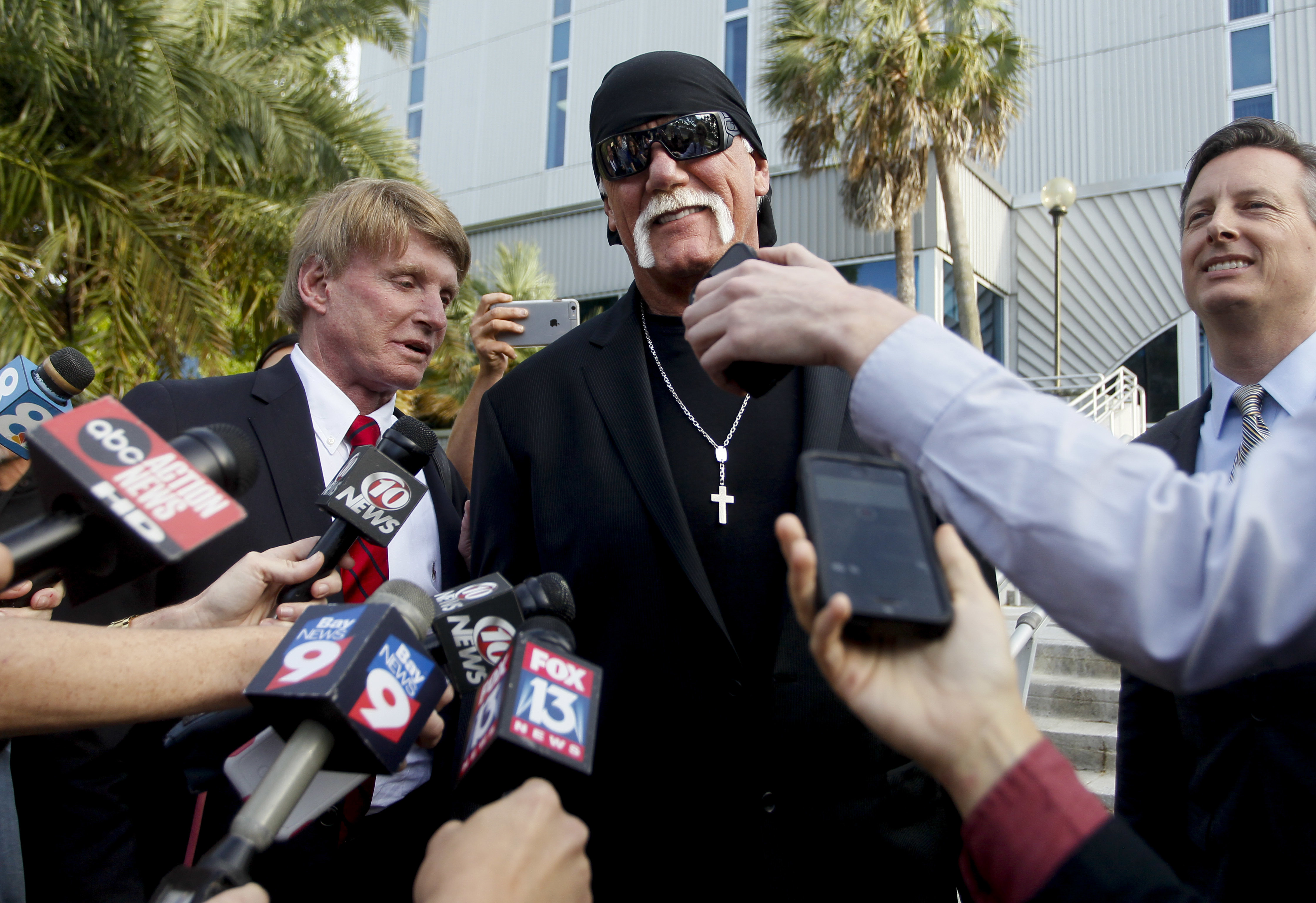 "FILE - In this March 21, 2016, file photo, Hulk Hogan, whose given name is Terry Bollea, speaks to the media St. Petersburg, Fla. Banished nearly three years ago from the wrestling organization in disgrace, the Hulkster is holding out hope for a reunion this year with the sports entertainment giant. Hogan would love to bust out the red-and-yellow colors for the ""Raw"" 25th anniversary show on Monday, Jan. 22, 2018, and join fellow wrestling greats in celebration of WWE's longest-running show. (Dirk Shadd/The Tampa Bay Times via AP, File)"