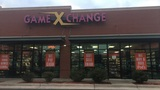 Armed suspect robs Game X Change store