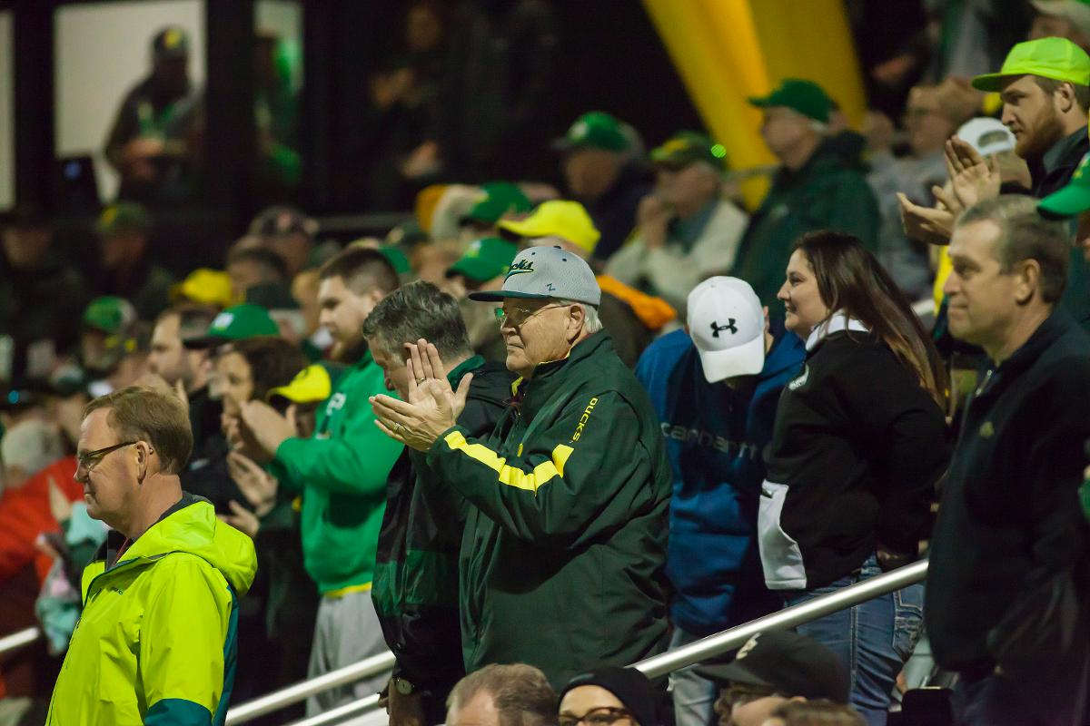 The Oregon crowd reacts to catcher Gwen Svekis' (#21) home run. In the first of a three game series the Oregon Ducks defeated the California Golden Bears five to one. Photo by Ben Lonergan, Oregon News Lab