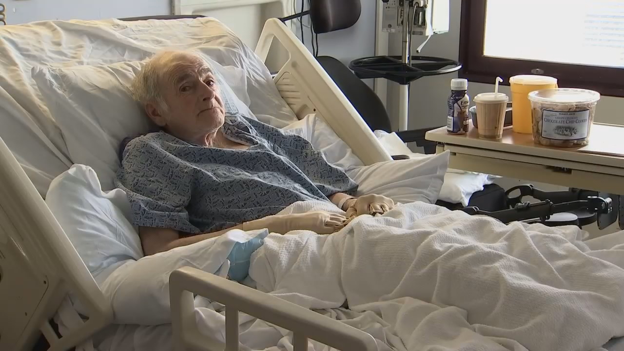 Homeless Seattle man going by the name Kenny Kenny has no legal identity. He is in rough physical shape as he lies in a University of Washington hospital bed. Homeless advocates are trying to figure out his legal identity. (Photo: KOMO News)