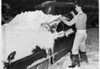 04_Man_clearing_snow_from_automobile_Seattle_February_1950.jpg