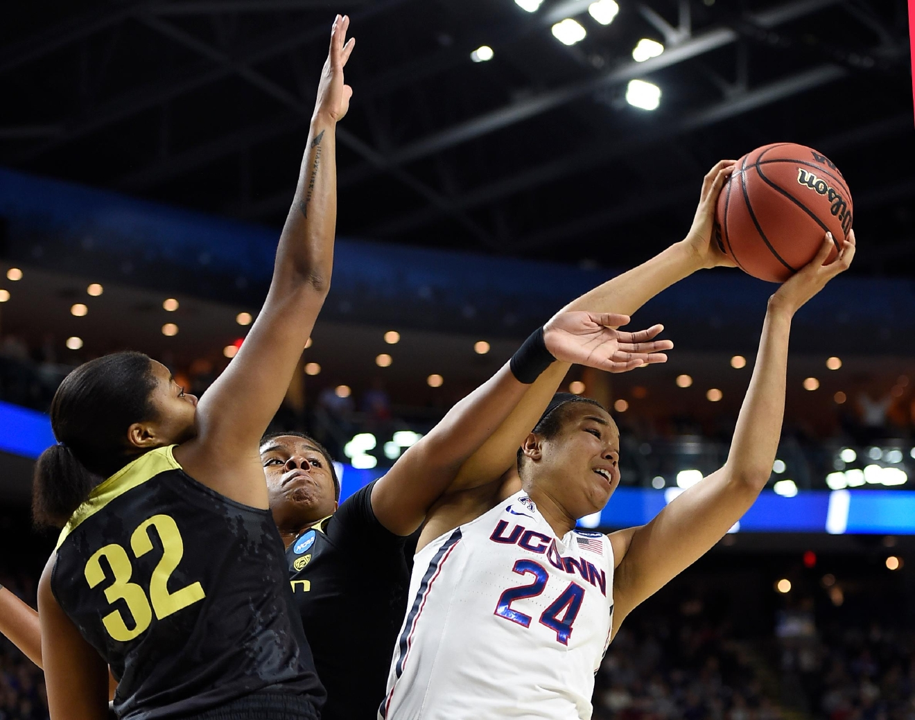 Oregon's Oti Gildon, left, and Oregon's Ruthy Hebard, center, defend against Connecticut's Napheesa Collier during the first half of a regional final game in the NCAA women's college basketball tournament, Monday, March 27, 2017, in Bridgeport, Conn. (AP Photo/Jessica Hill)