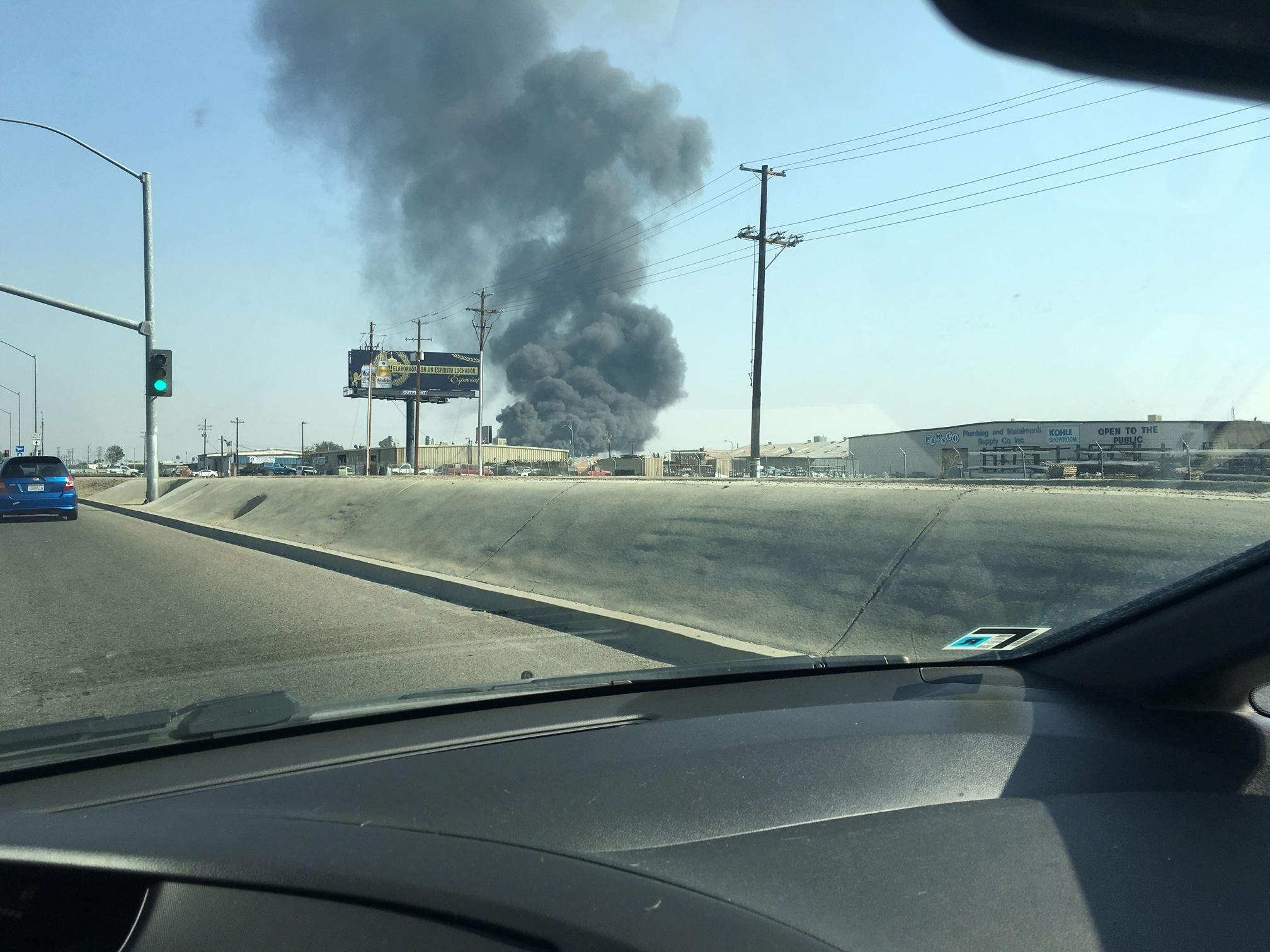 Pallet fire in Fresno releases large black smoke column (Photo Paige McIntyre / FOX26)