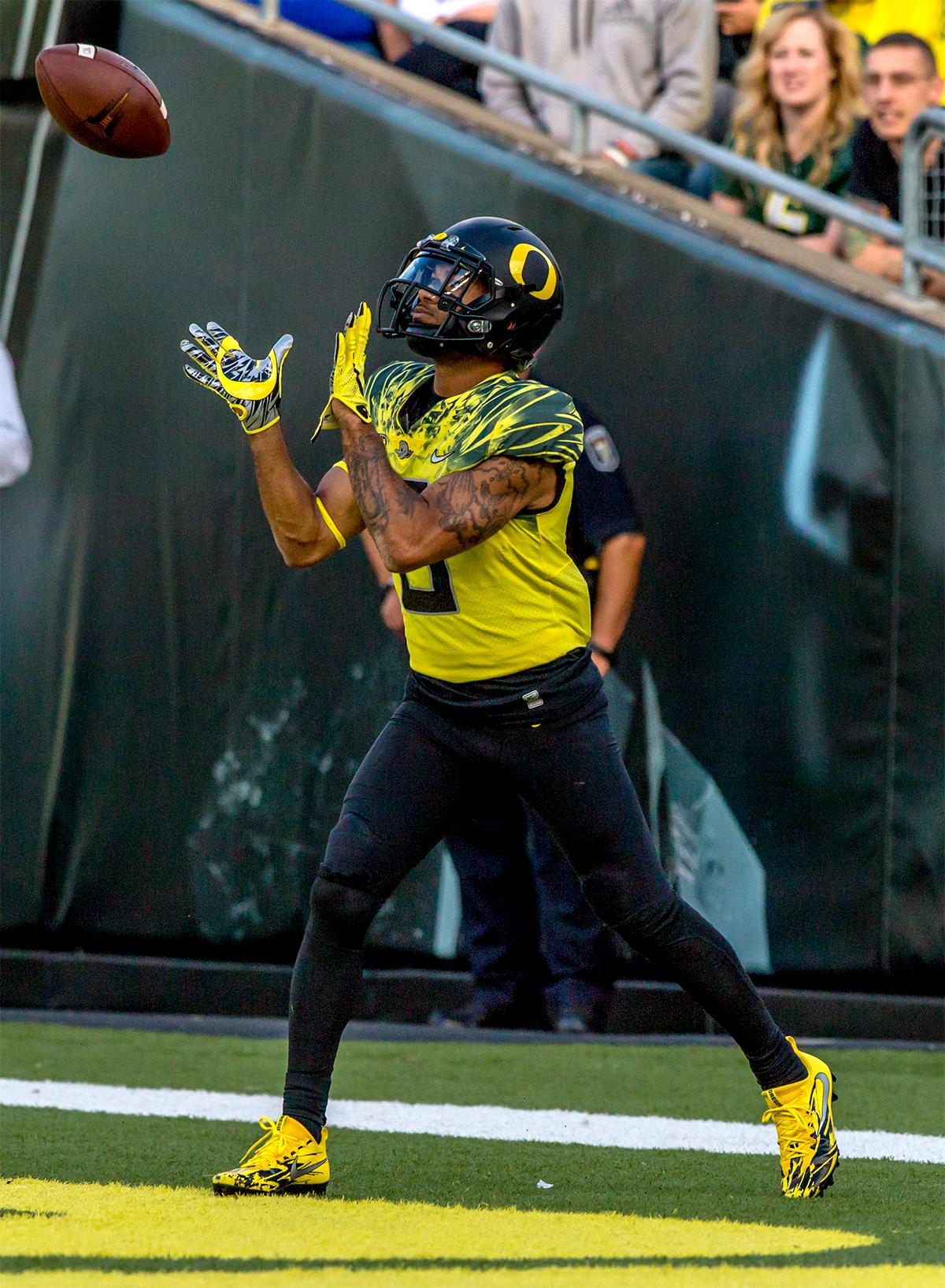 The Duck's Charles Nelson (#6) catches the kickoff. The Oregon Ducks broke their losing streak by defeating the ASU Sun Devils on Saturday 54-35. Photo by August Frank, Oregon News Lab
