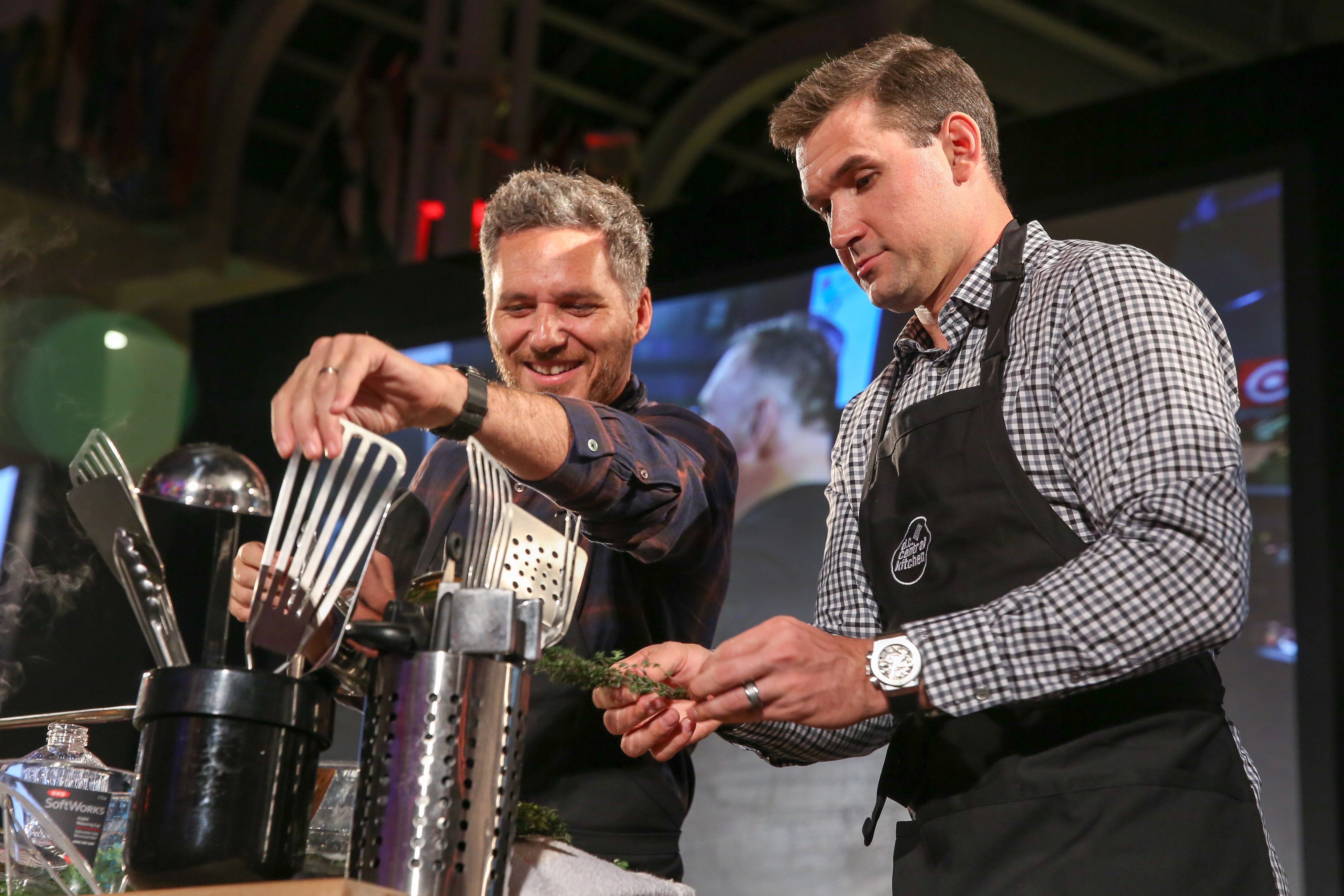 Ryan Zimmerman and co-host Spike Mendelsohn made a dish for a competition after the main event. (Amanda Andrade-Rhoades/DC Refined)
