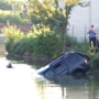Two men dead following car crash into pond, investigation conintues